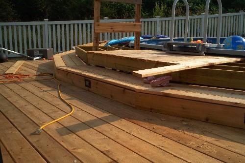 Deck boards cut around pool